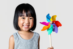 Asian Little Chinese Girl Playing Colorful Pinwheel Royalty Free Stock Photo