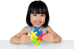 Asian Little Chinese Girl Playing Colorful Puzzle Royalty Free Stock Photo