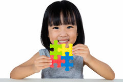 Asian Little Chinese Girl Playing Colorful Puzzle Royalty Free Stock Image