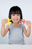 Asian Little Chinese Girl Playing Colorful Puzzle Stock Photo