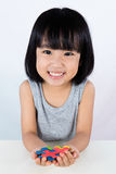 Asian Little Chinese Girl Playing Colorful Puzzle Stock Images