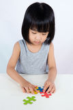 Asian Little Chinese Girl Playing Colorful Puzzle Royalty Free Stock Photography