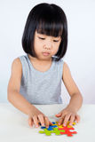 Asian Little Chinese Girl Playing Colorful Puzzle Stock Photography
