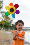 Asian Little Chinese Girl Playing Colorful Windmill Royalty Free Stock Photography