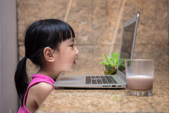 Asian little Chinese girl playing computer Royalty Free Stock Image