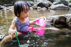 Asian Little Chinese Girl Playing in Creek Stock Images
