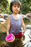 Asian Little Chinese Girl Playing in Creek Royalty Free Stock Photos