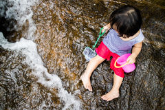 Asian Little Chinese Girl Playing in Creek Stock Photos