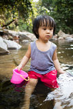 Asian Little Chinese Girl Playing in Creek Stock Photography