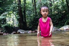 Asian Little Chinese Girl Playing in Creek Royalty Free Stock Photography