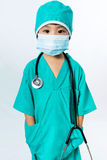 Asian Little Chinese Girl Playing a Doctor with Mask and Stethos Royalty Free Stock Photos