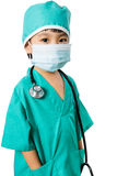 Asian Little Chinese Girl Playing a Doctor with Mask and Stethos Royalty Free Stock Photography