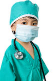 Asian Little Chinese Girl Playing a Doctor with Mask and Stethos Stock Image
