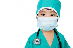 Asian Little Chinese Girl Playing a Doctor with Mask and Stethos Royalty Free Stock Images