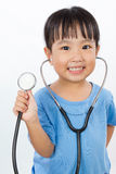 Asian Little Chinese Girl Playing Doctor with a Stethoscope Royalty Free Stock Photography