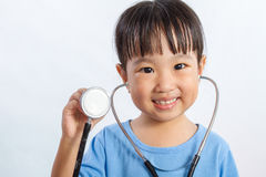 Asian Little Chinese Girl Playing Doctor with a Stethoscope Royalty Free Stock Images