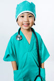 Asian Little Chinese Girl Playing a Doctor with Stethoscope Stock Image