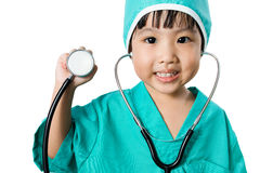 Asian Little Chinese Girl Playing a Doctor with Stethoscope Royalty Free Stock Images