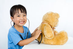 Asian Little Chinese Girl Playing Doctor with Teddy Bear Stock Photography