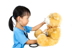 Asian Little Chinese Girl Playing Doctor with Teddy Bear Royalty Free Stock Images