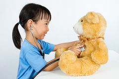 Asian Little Chinese Girl Playing Doctor with Teddy Bear Royalty Free Stock Photo