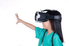 Asian Little Chinese Girl playing doctor with VR goggles Stock Photos