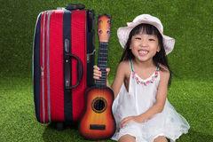 Asian Little Chinese girl playing with guitar Stock Photography