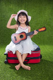 Asian Little Chinese girl playing with guitar Stock Photo