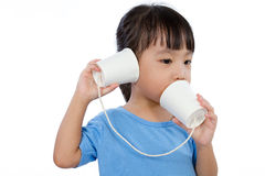 Asian Little Chinese Girl Playing with Paper Cups Stock Images