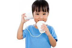 Asian Little Chinese Girl Playing with Paper Cups Royalty Free Stock Photography