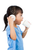 Asian Little Chinese Girl Playing with Paper Cups Royalty Free Stock Images