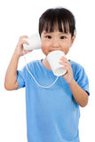 Asian Little Chinese Girl Playing with Paper Cups Stock Image