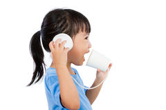 Asian Little Chinese Girl Playing with Paper Cups Royalty Free Stock Image