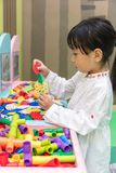 Asian Little Chinese Girl playing puzzle Stock Photo
