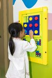 Asian Little Chinese Girl playing puzzle. At Indoor Playground Royalty Free Stock Images