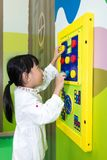 Asian Little Chinese Girl playing puzzle Stock Image