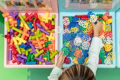 Asian Little Chinese Girl playing puzzle. At Indoor Playground Royalty Free Stock Photography