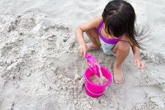 Asian Little Chinese Girl Playing Sand with Beach Toys Stock Images