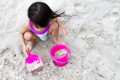 Asian Little Chinese Girl Playing Sand with Beach Toys Royalty Free Stock Images