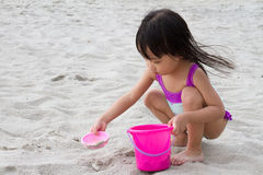 Asian Little Chinese Girl Playing Sand with Beach Toys Stock Photo