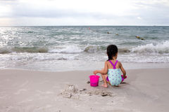Asian Little Chinese Girl Playing Sand with Beach Toys Stock Photos