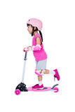 Asian little Chinese girl playing with scooter Stock Images