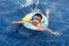 Asian Little Chinese Girl Playing in Swimming Pool royalty free stock photos