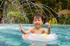 Asian Little Chinese Girl Playing in Swimming Pool Stock Images