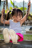 Asian little Chinese girl playing swing. At outdoor park Royalty Free Stock Photography