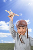 Asian Little Chinese Girl Playing with Toy Airplane Royalty Free Stock Photo