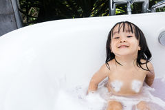 Asian little Chinese girl playing with water and foam Royalty Free Stock Photos