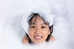 Asian little Chinese girl playing with water and foam Royalty Free Stock Photo