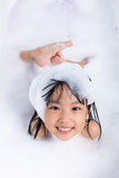 Asian little Chinese girl playing with water and foam Royalty Free Stock Image