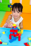 Asian Little Chinese Girl Playing Wooden Blocks Stock Images